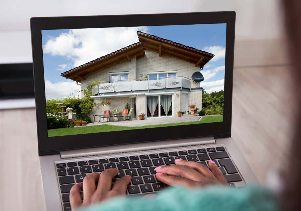 searching for homes on computer