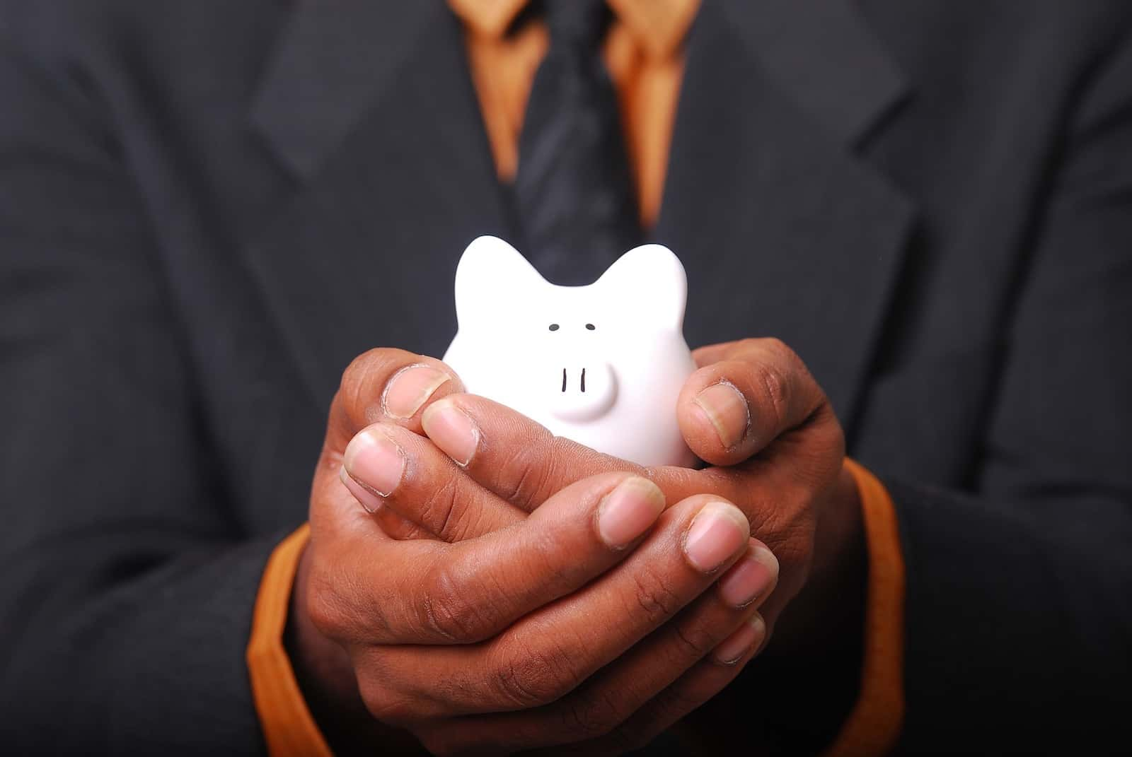 man holding a piggy bank, how much can i afford